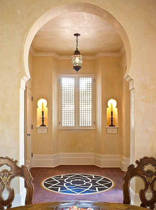 Wooden shutters and brick floors help keep the interior cool.