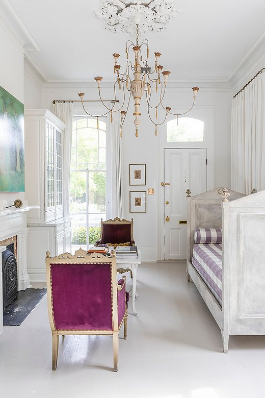 """Chandeliershang in nearly every room of Julie's home.Her love of the style extends back to one of her first commissioned pieces, which wascrafted for a show house by an artisan who specialized in creating copper fountains. """"He made my first chandelier, and the rest was history,"""" she says."""
