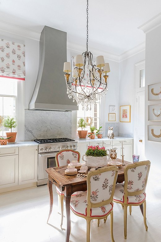 A crystal chandelier adds whimsical elegance to Julie's kitchen—a room Julie says should not be overlooked when it comes to statement-making lighting.
