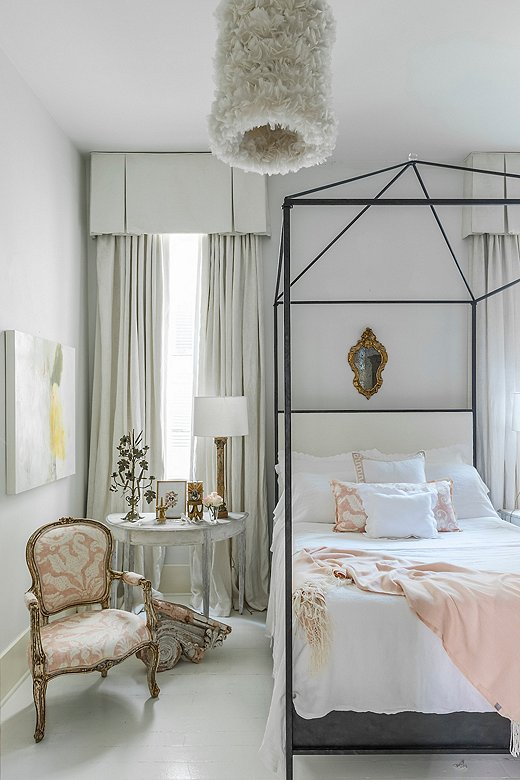 Julie opted for something unexpected for her bedroom lighting, which she made by gluing feathers onto a large lampshade.