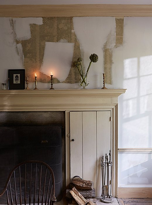 Beauty in progress: Candlelight flickers against partially primed walls in the dining room.