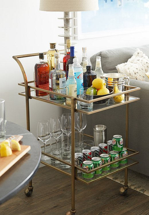 As an alternative to a side table, Andrew placed a lamp on a bar cart so that it can be used as a side table and to hold beverages.