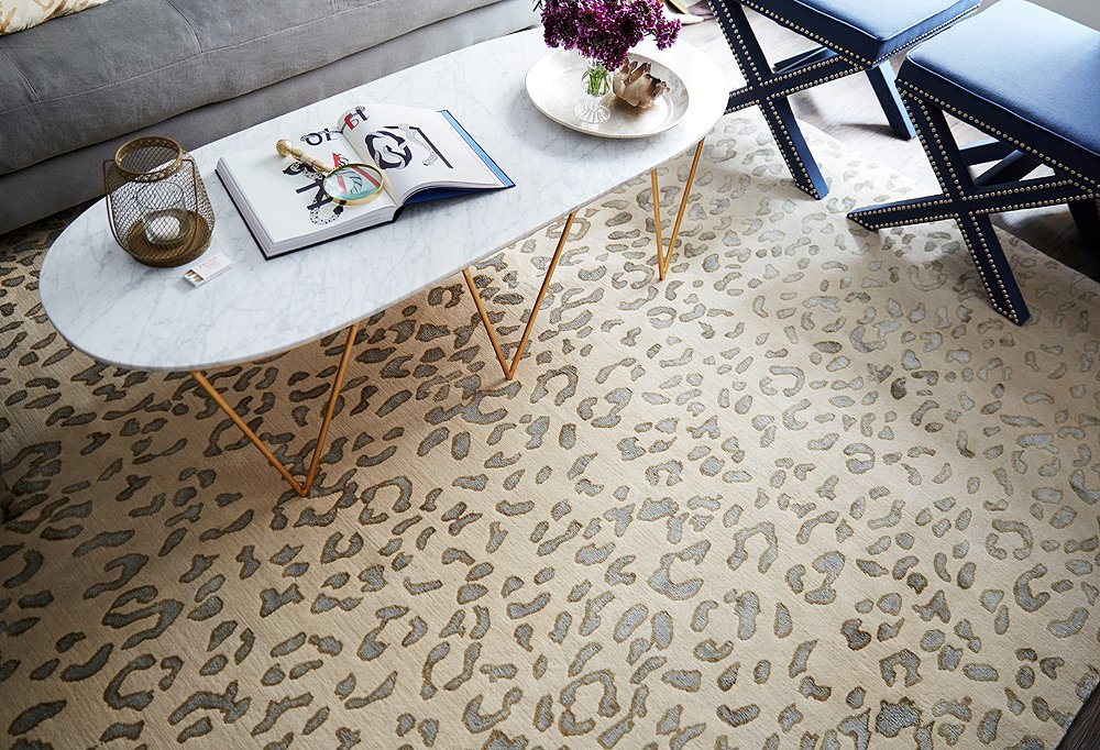 A leopard rug in a soft palette defines the open seating area and makes it feel like a true living space of its own.