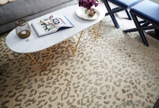 a leopard rug in a soft palette defines the open seating area and makes it feel