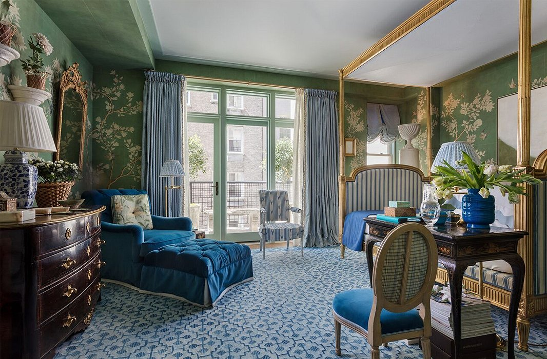 Blue is a component of green, so you can feel safe pairing the two hues. Here the green background of the walls provides chic support to the palette of blues. Photo by Nickolas Sargent.