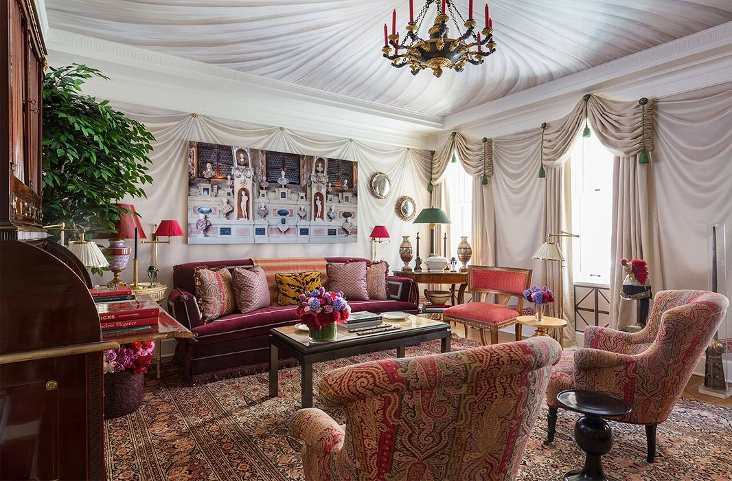 "Alexa Hampton dubbed her room the ""Olympia Folly."" The designer's appreciation of neoclassicism is on full display with trompe l'oeil tented walls, photographs of Greek architecture, and a tailored compilation of antiques and patterns ranging from paisley to Le Tigre."
