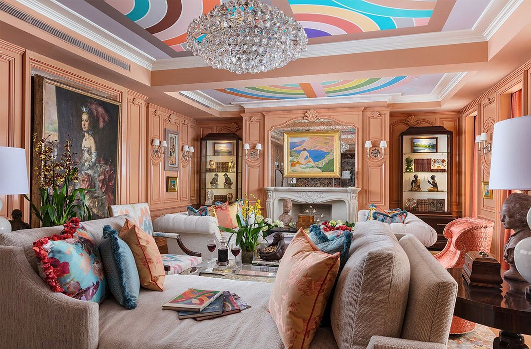 """Art and à la carte,"" says Barbara Ostrom when asked about her salon-style space. Envisioning it as a place of refuge for a pair of avid art collectors, she included works by John Mellencamp alongside cases filled with first-edition tomes and a Han Dynasty horse. Oh, and the ceiling? Frank Stella prints refashioned as wallpaper. Peachy walls glossed to perfection yield divine complexions for all who enter."
