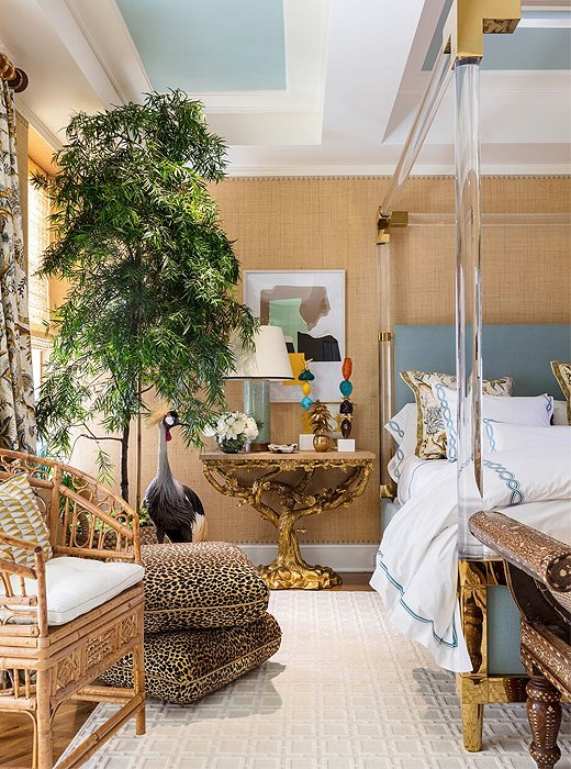 Rome-born designer Alessandra Branca has long created spaces that combine classic beauty with everyday comfort, and her Kips Bay bedroom is no exception. The sunshine-infused palette of yellow, gold, and blue fashions aserene atmosphere. Old World touches such as a sculptural gold console were paired with such contemporary anchors as an acrylic-and-brass four-poster bed.