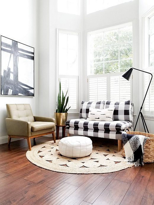 """Tastemaker Keely Mann also used an oversize gingham, this time on a settee, to create what she called """"the perfect addition"""" to a room she'd been struggling to complete. Photo courtesy of Keely Mann."""