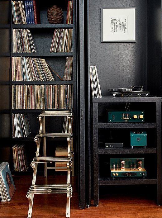 "A sculpture bought at auction was intended to be used as a stepladder but turned out to be too heavy to move. The collection of records, many picked up along the couple's travels, is something of a prized possession. ""My husband and I are both music-lovers,"" says Kim. ""I grew up in a house with R&B, disco, jazz, and funk, and he grew up in a house where they were only allowed to listen to classical music. I've definitely introduced him to a few new things."""