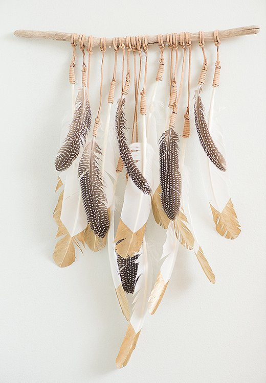 When she's creating a piece, Kristen will select feathers one by one based on where and how they'll hang.
