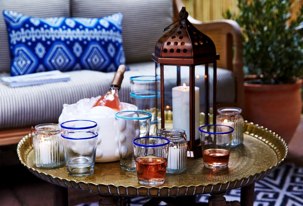 The removable brass tray on the vintage Moroccan table is just the thing Day needed for easy entertaining.