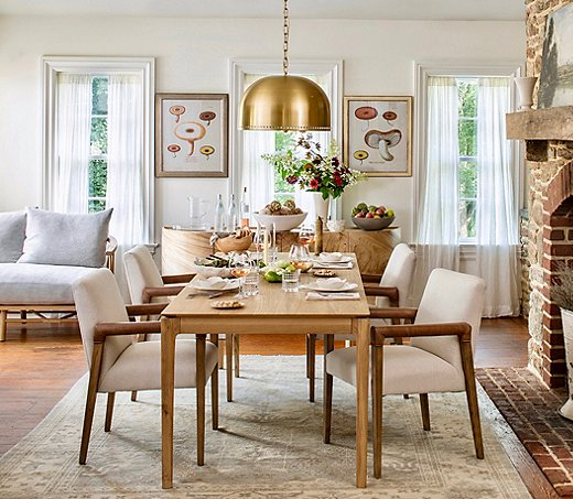 """Lauren's """"Mushroom Study Set""""hangs in this dining room. The Theo Dome Pendant Light adds another vintage touch to the room."""