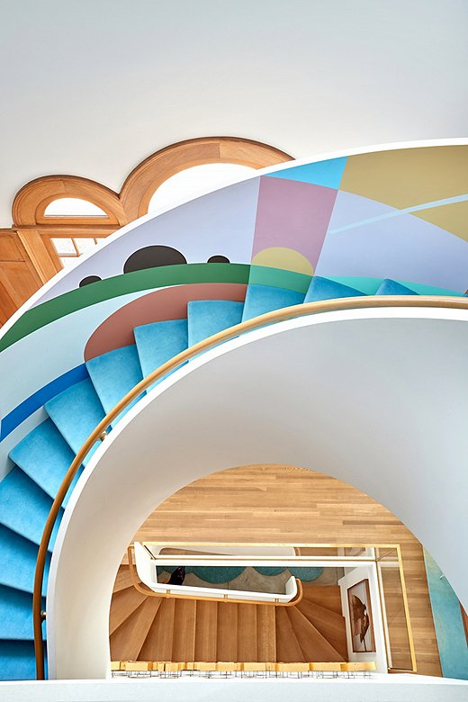 Chet tapped Adrian Kay Wong to paint a colorful abstract mural on the winding staircase.