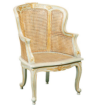 A painted and gilded Rococo cane-seated bergère.
