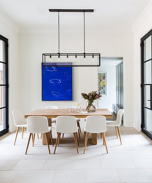 The dining area off the kitchen is simplicity at its best. The steel-framed windows and doors speak to a refined elegance of clean lines and subtle power.