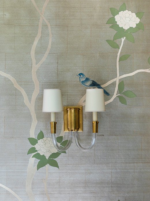 """We wanted to do a traditional chinoiserie wallcovering from Gracie Studio but in a fresh, impressionist way,"" says Marie. The Gracie team brought her vision to life by minimizing the blooms and leaves on the tree. The effect was the dramatic and well-known look of Gracie designs in a more sculptural manner."