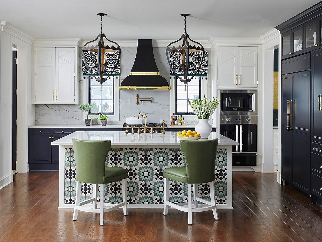 The custom tile on the island, the striking pendants, and the patterned window shades referenced the client's love of all things Moroccan and French.