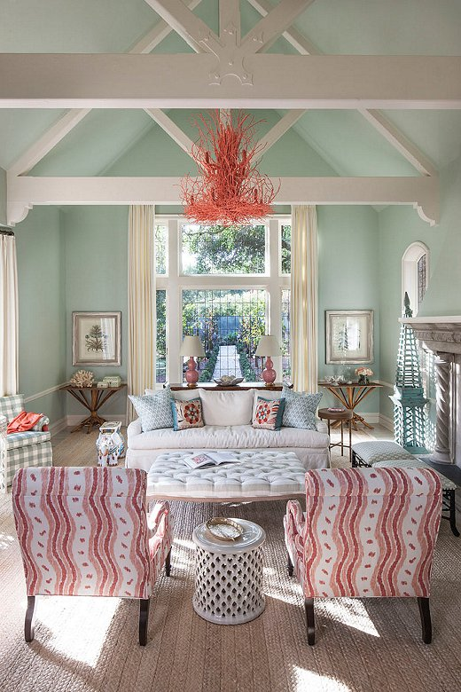"""The flow of color throughout the living room makes it feel grounded, less grand. """"The chandelier brings in the color palette we had going on below,"""" says Melissa. """"There's a formality to the space and we wanted to throw that off."""""""