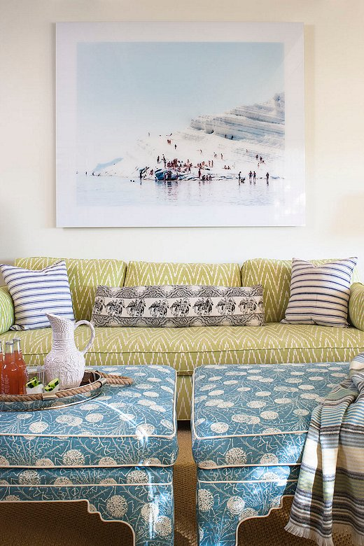 """The pattern-filled family room needed a dash of something classic to pull it together. This beach scene from famed Italian photographer Massimo Vitali did just that. """"We always make sure there is something clean that relaxes your eye in a room,"""" says Melissa."""