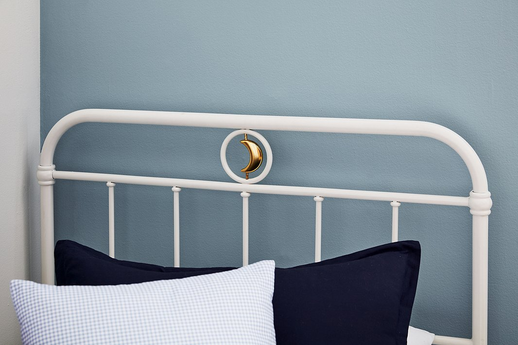 Kids will be over the moon about quirky details such as the spinning crescent on the Ellis bed.