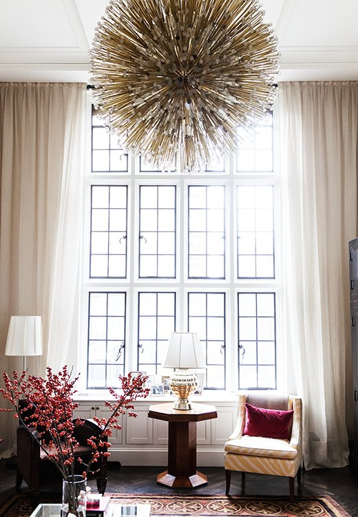 A '50s chandelier adds sparkle (and drama!) to the space. It also highlights the room's sky-high ceilings.