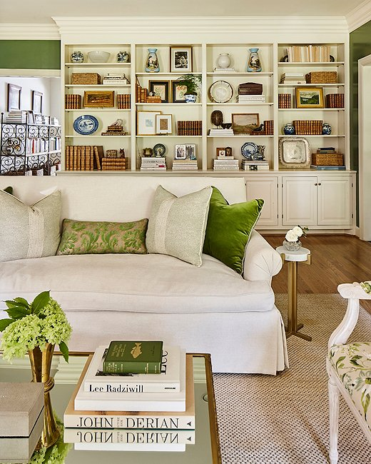 Green and white accents add an air of traditional gravitas to this living room. Photo by Laurey Glenn.