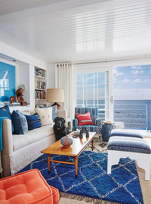 "Vintage fabric was used to upholster the seating in this beach house ""to create a relaxed, perfectly worn-in look,"" writes Nathan."