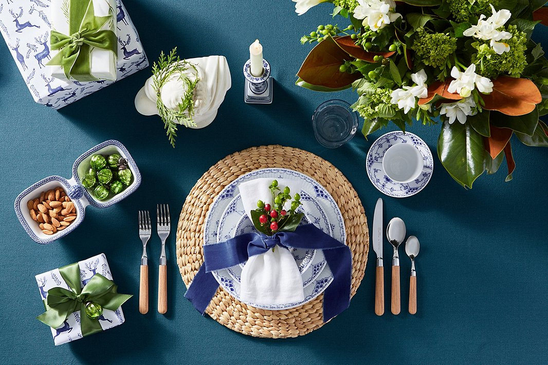 Plates, cup, and saucer: Royal Copenhagen Half Lace; flatware, Vietri Albero.