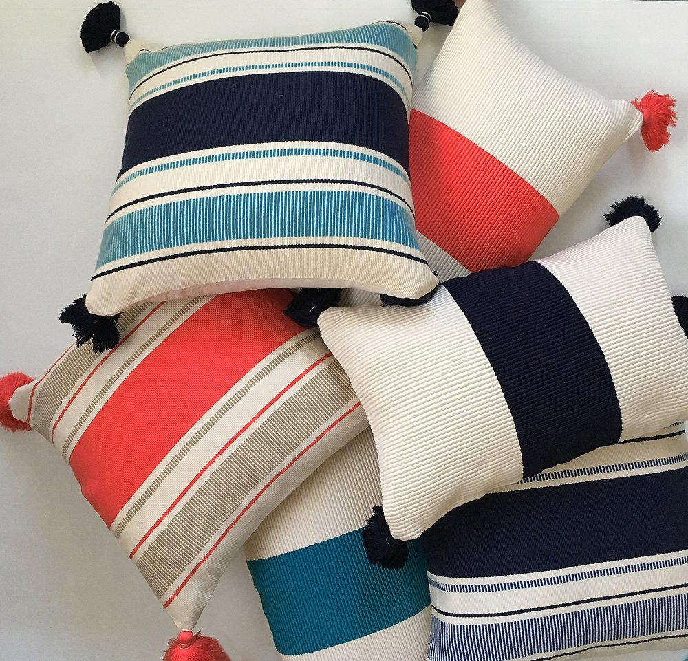 The Cabana Stripe and Laguna Stripe pillows are handwoven by Peruvian artisans on Incan backstrap looms.