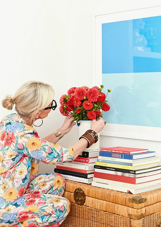 Gen arranges flowers in front of Color Study XXII.