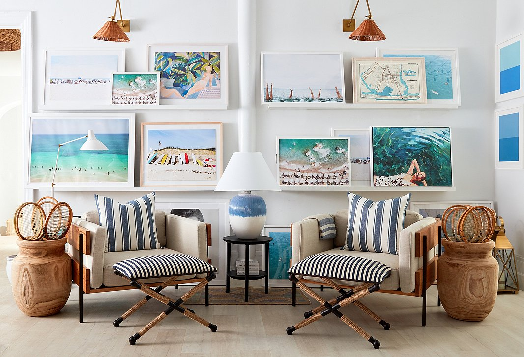 We've stocked the shop with plenty of summer-inspired art by Hayley Mitchell, Judith Gigliotti, Natalie Obradovich, T.S. Harris, and others. The woven sconces by Arteriors, the striped ottomans, and the exclusive brushstroke table lamp add more seaside charm.