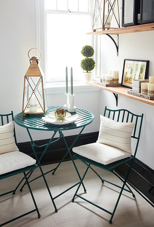 A bistro set is perfect for small outdoor spaces or for livening up an empty corner.
