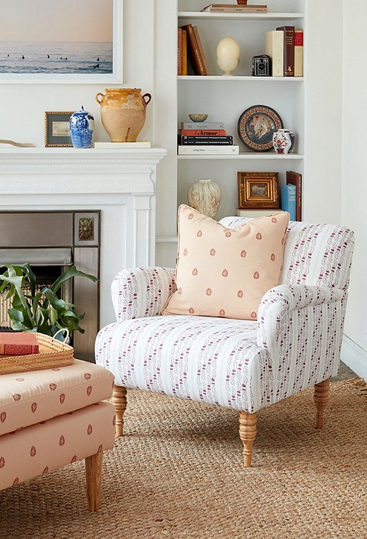 The Agave Stripe, seen here as a club chair and paired with the Mariposa pillow in peach, is a whimsical print with classic structure.