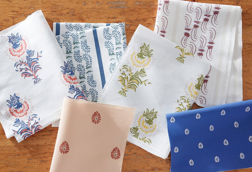 All the prints from the collection were originally hand-drawn and are inspired by Indian block prints and English floral designs. Top row, from left to right: Desert Flower in lapis/coral, Agave Stripe in indigo, Desert Flower in spring green, Agave Stripe in berry. Bottom row, from left to right: Mariposa in peach and Mariposa in lapis.