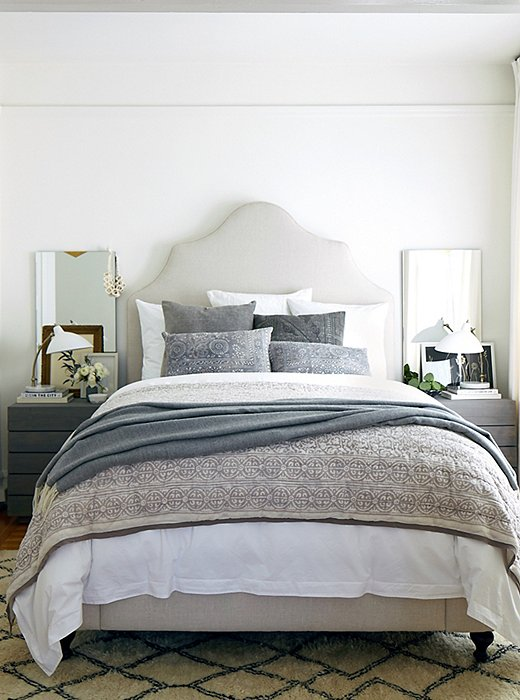 A duvet, a quilt, a throw: You can't have too many layers on your bed in fall and winter. Photo by Laura Resen.