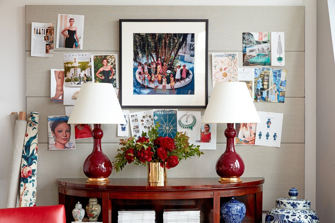An iconic Slim Aarons photograph of Lilly Pulitzer-clad ladies in Palm Beach—another gem from the magazine's archives—accents a conference room wall. A subtle Ralph Lauren Home ticking stripe livens up a generic office pinboard, while the mahogany Oriel Console, also by Ralph Lauren Home, provides stylish storage.