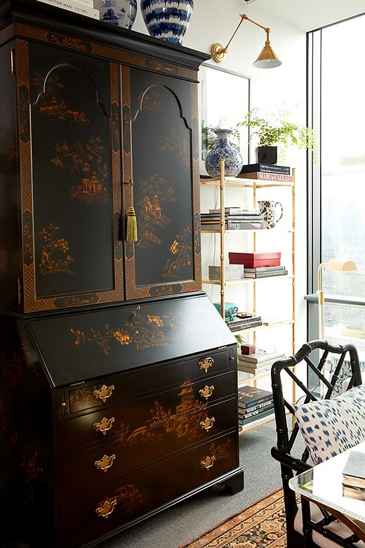 "With its gorgeous chinoiserie imagery and glossy black background, it's no surprise the Magdalene Secretary from Ralph Lauren Home is a favorite moment of Stellene's. ""It's the most beautiful desk you can imagine,"" she says."