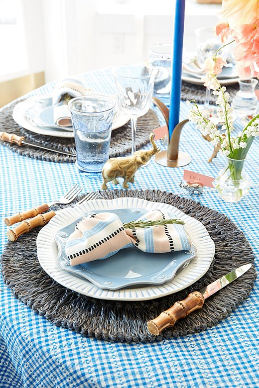 Eddie likes to start with a beautiful tablecloth when setting the scene, and Heather Taylor Home's linens add just the right amount of personality and color. Try knotting the napkin and tucking in a sprig of rosemary for an easy, elevating accent.