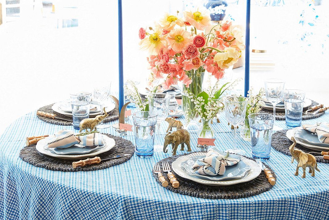 Jane's signature table always includes extra-tall candles from Creative Candles, whichare seen here amid Juliska's Loop place mats, bamboo flatware, Sitio Stripe dinner plates, Berry & Thread salad plates, Carine tumblers, and Vienne white-wine glasses.