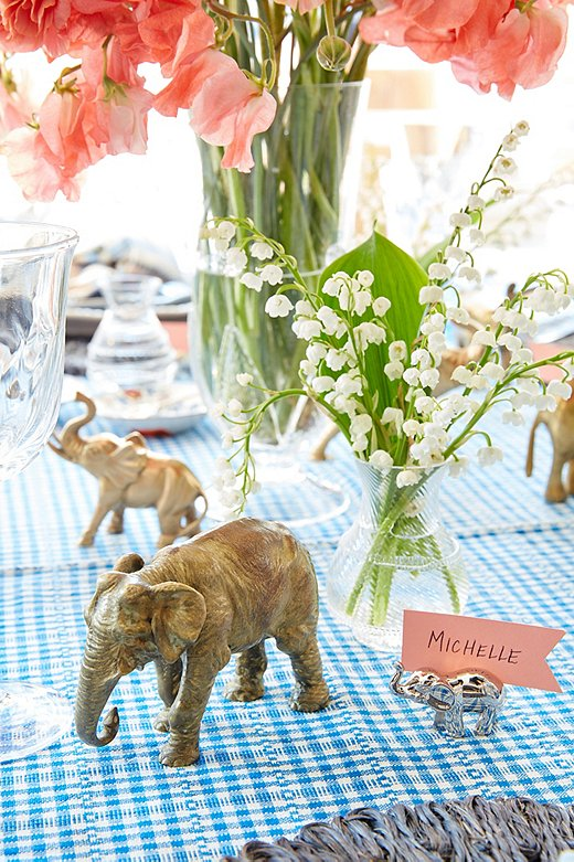 Susan has been collecting elephant figurines for years and pulls them from around her house to add to her table when she entertains. Juliska's mini vases and Acanthus vasemake up the rest of the centerpiece.