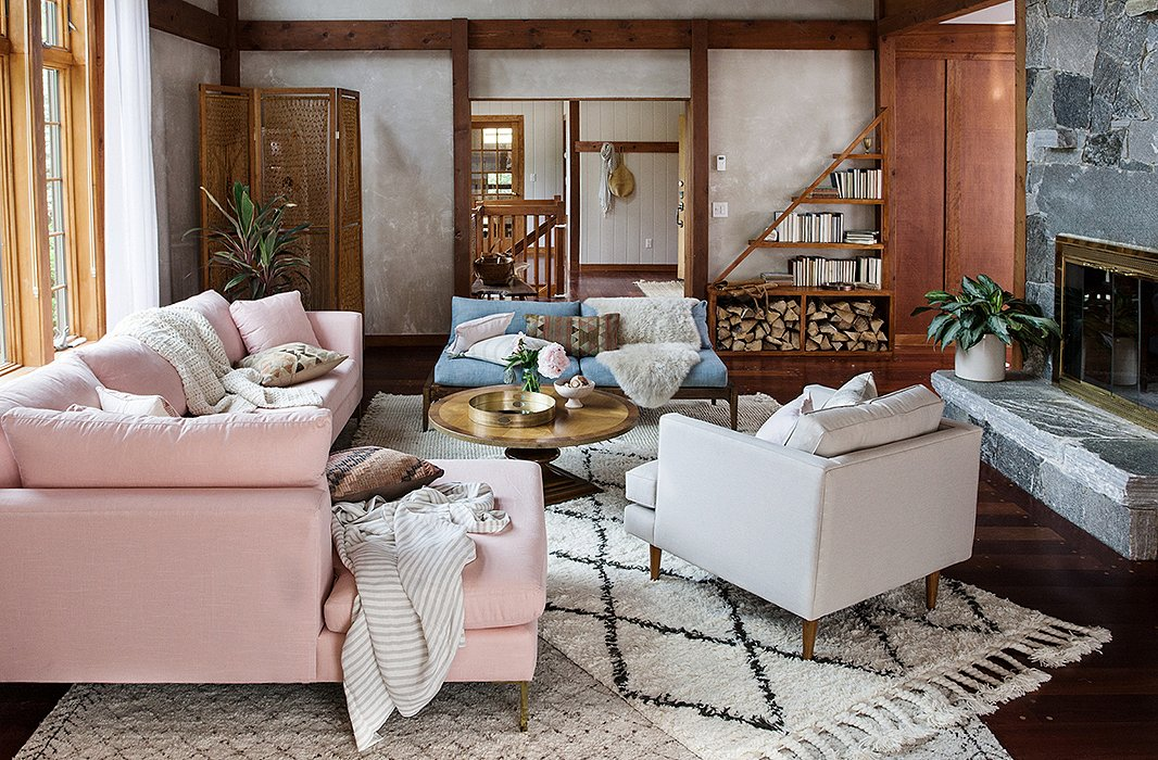 Layered rugs—Moroccans and a tightly woven fringed mat—ground the main living area in the beach house, where pastel hues pop against the neutral tones.