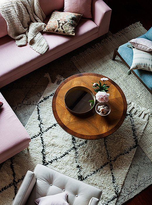 Tara purposefully placed a Moroccan rug asymmetrically to define the seating area as well as to draw the eye to the shaggy, cozy layers underfoot.