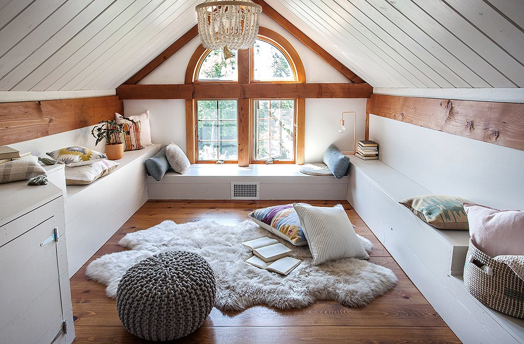 Textures abound in the attic loft, where sheepskins are layered with kilim pillows and a knit pouf, perfect for lazy lounging.