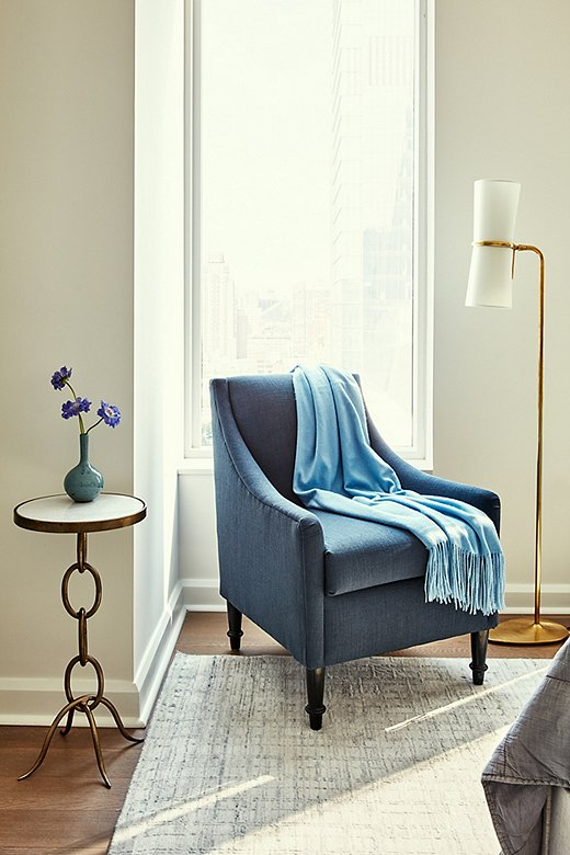 Never one to give up an opportunity to maximize seating options, Becca chose a chair with a small silhouette that fits just so in the corner of the master bedroom. She selected blue to keep the color palette cohesive throughout the room.