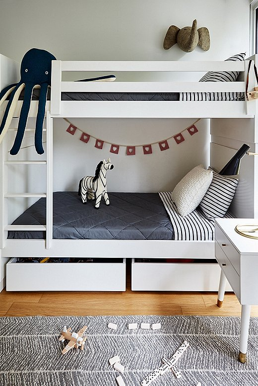 """The kids are obsessed with the elephant,"" Michael says of the plush animal hanging above the bunk bed. ""I was telling them Elsie is the name of the One Kings Lane elephant mascot, so they decided its name should be Elsie Junior."""