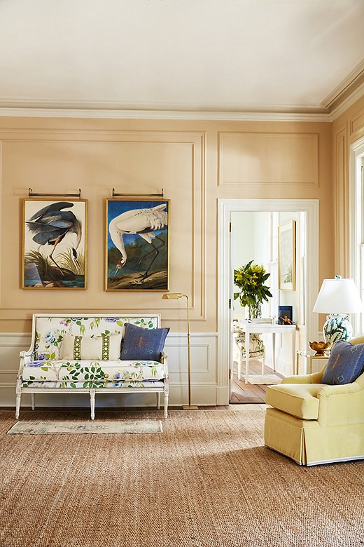 Two Audubon reproductions are given place of honor above a floral-print settee. The natural-fiber rug reinforces the back-to-nature motif.