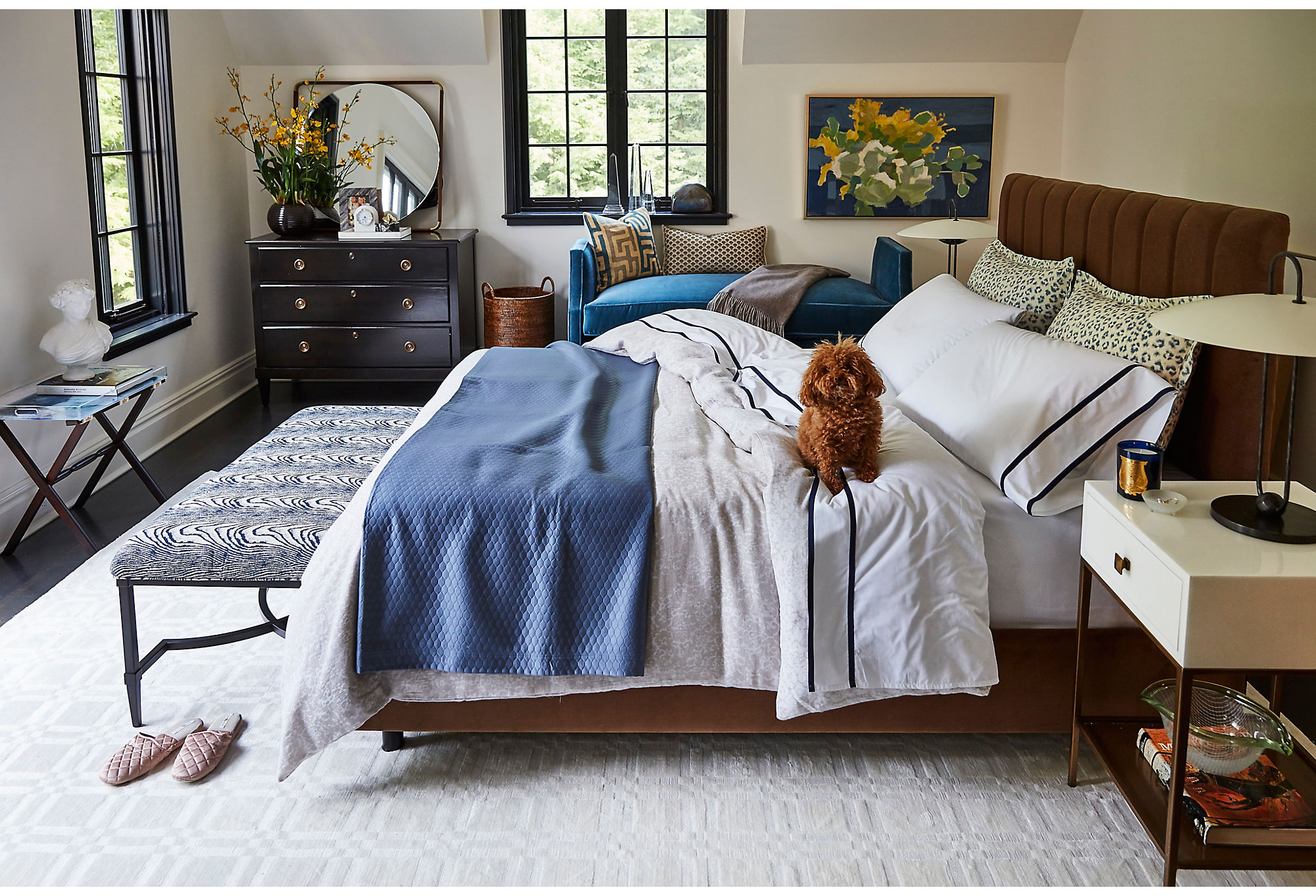 Blue-and-white bedding is a good choice year-round. Furniture in deeper tones, such as our exclusive Dumont Bench in Harbor Blue (against the wall) and the Delmar Channel Bed in Sand Velvet, bring an air of fall into the room.