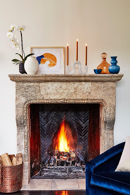 Abstract art by Rebecca Stern and the Corinth Large Marble Candleholder add a modern twist to this classic mantel.