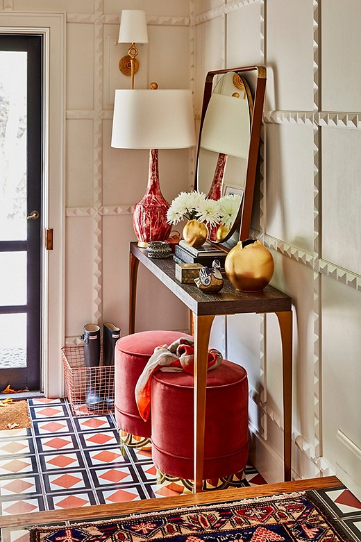Persimmon is another color we're loving this fall. These Piper Stools from Kim Salmela add a touch of glam to an entryway full of texture and pattern.